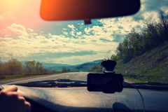 Driving a car on mountain road. View from windscreen. Driving a car on mountain road Royalty Free Stock Photo