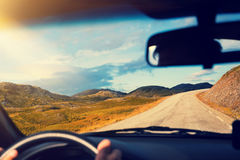 Driving a car on mountain road Royalty Free Stock Photography