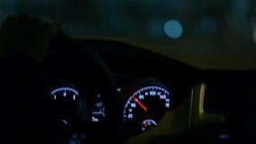 Driving a car.