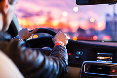 Driving a car at night Stock Image