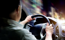 Driving a car at night Stock Photography