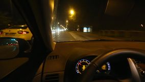 Driving a car at night stock video