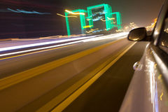 Driving car in the night. View from side of car,blurred motion Royalty Free Stock Photos