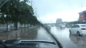 Driving car in raining stock video