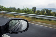 Driving the car on a rainy day. Driving during the rainy day stock photo