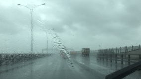 Driving a car during rainy weather stock video