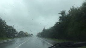 Driving a car during rainy weather stock video footage