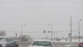 Driving car on slippery roads during cold winter snow storm stock video