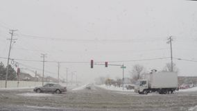 Driving car on slippery roads during cold winter snow storm stock video footage
