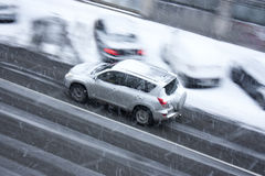 Driving car on snowy city street Royalty Free Stock Photography