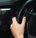 Driving a Car. Steering Wheel. Driving with navigation. modern car Stock Photography