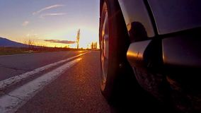 Driving a car at sunset stock footage