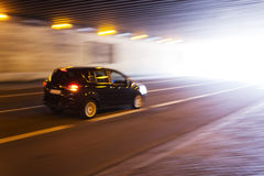 Driving car in a tunnel Stock Photo