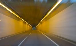 Driving a car through a tunnel. Stock Photos