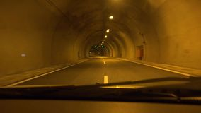 Driving Car in Tunnel, Subway Traffic in Mountains, Traveling in Greece, Pov.  stock video footage