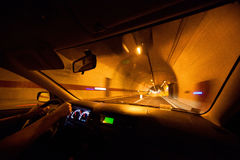 Driving car through tunnel Stock Photography