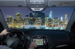 Driving using navigation system towards Manhattan skyline, New Y. Driving a car while using the touch screen of a GPS navigation system towards Manhattan skyline stock photos