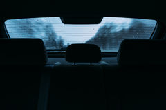 Driving a car in the view the rear window Royalty Free Stock Photo
