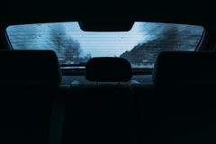 Driving a car in the view the rear window Royalty Free Stock Image
