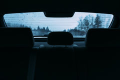 Driving a car in the view the rear window Royalty Free Stock Images