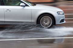 Driving car on a wet street. In motion blur Royalty Free Stock Images