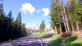 Driving car on the winding roads in the Dolomites in early spring, Alps stock footage
