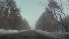 Driving car in winter in fog. HD stock footage