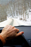 Driving car on winter road. In forest countryside Royalty Free Stock Photo