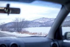 Driving a car on a winter road royalty free stock image