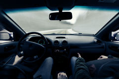 Driving a car on winter road Stock Photography
