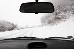 Driving a car in winter Royalty Free Stock Photography