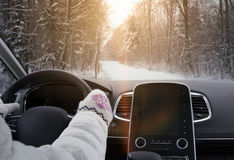 Driving car in winter Stock Photos