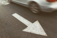 Driving car in wrong direction against traffic arrow sign Stock Images
