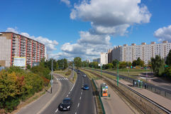 Driving cars. POZNAN, POLAND - SEPTEMBER 27, 2015: Cars driving on a road close to apartment buildings Royalty Free Stock Photography