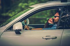 Driving with the Cell Phone. Caucasian Men in His 30s Making Mobile Call While Driving stock image