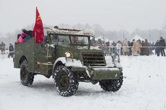 Driving of children on the American armored prospecting M3A1 `Scout Сar`. A fragment of the military-historical festival Stock Images