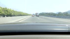 Driving in Chinese highway. With traffic jam and going through two tunnels stock footage