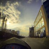 Driving in the city on a motorcycle Royalty Free Stock Photography