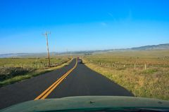 Driving in a country. Along pastures Stock Photos