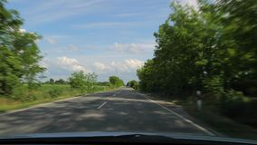 Driving a car. Driving on a country road