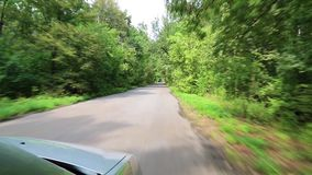 Driving on a country road. Video filming from moving car stock footage
