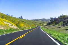 Driving through the countryside on a sunny spring day. California stock photo