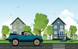 Driving in the countryside. Women driving on a road with houses in the background Stock Photography