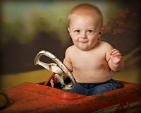 Driving crazy 3. Baby boy in antique firetruck Stock Image