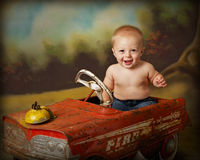 Driving crazy 5. Baby boy in antique firetruck Royalty Free Stock Image