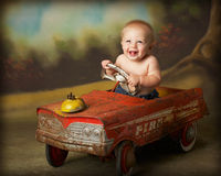 Driving crazy 5. Baby boy in antique firetruck Stock Photos