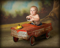 Driving crazy 5. Baby boy in antique firetruck Stock Images