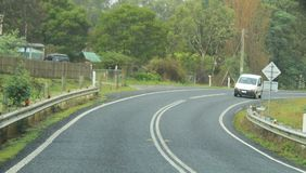 Driving on curve winding  Arthur Road, Tasmania. Way from Boomer Island and Boomer bay on Arthur Highway on way to Port Arthur, Hobart, Australia Stock Images