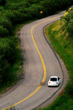 Driving on curved road Royalty Free Stock Photo