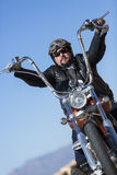 Driving a customized motorcycle Royalty Free Stock Photo